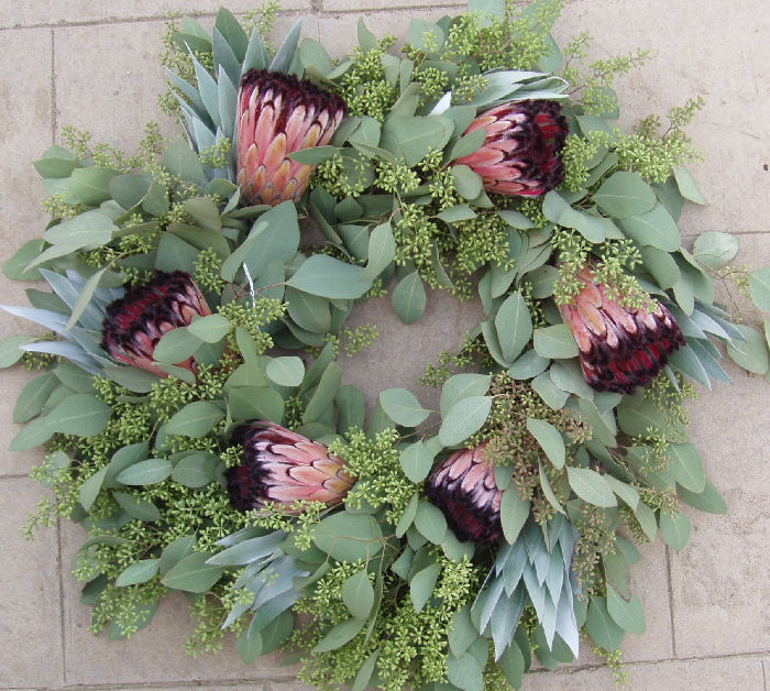FRESH PINK & BLACK MINK WITH SILVER TREE & SEEDED EUCALYPTUS PROTEA WREATH